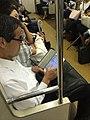 Man Reading Newspaper 2015 (20840740083).jpg