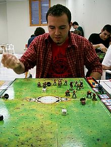 Man playing Blood Bowl.jpg