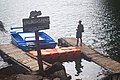 Man standing on wooden piers at Lake Balinsasayao 01.jpg