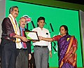Manish Tewari presenting the Limca Book of Record 'People of the Year'2013 to the Iconic Documentary Film-Maker, Shri Mike Pandey, at a function, in New Delhi on April 10, 2013.jpg