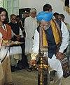 Manmohan Singh lighting the traditional lamp at Shantiniketan Griha, in Kolkata, West Bengal. The Union Minister of External Affairs.jpg