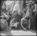 Manzanar Relocation Center, Manzanar, California. Evacuees of Japanese ancestry watching Memorial D . . . - NARA - 538541.tif