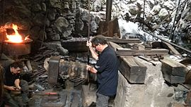 A blacksmith at Montgaillard Forge