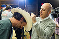 Matt Lauer autographing a hat.jpg