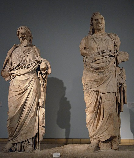 Colossal statues of a man and a woman from the Mausoleum at Halicarnassus, traditionally identified as Artemisia II and Mausolos, around 350 BCE, British Museum. Mausoleum at Halicarnassus, British Museum (8244599061).jpg