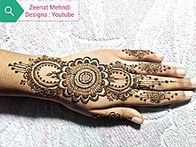 Mehndi decoration on back side of hands.jpg