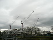 Melbourne Rectangular Stadium construction - MCG in background.JPG