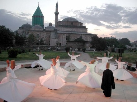 The Whirling Dervishes, or Mevlevi Order by the tomb of Sufi mystic Rumi Mevlana Konya.jpg