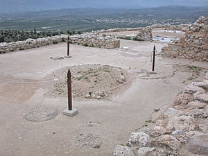 Megaron - Foundation of the Megaron complex at Mycenae, view from the main hall (circular hearth visible in foreground) through the anteroom and porch.
