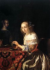 Young Woman threading Pearls