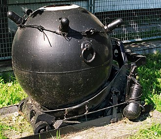 Naval mine - Polish wz. 08/39 contact mine. The protuberances near the top of the mine, here with their protective covers, are called Hertz horns, and these trigger the mine's detonation when a ship bumps into them.