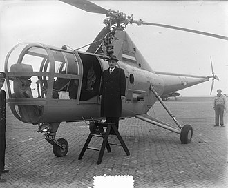 Willem Drees - Drees as Prime Minister in 1953, boarding an helicopter heading to the areas damaged by the North Sea flood