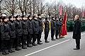 Ministru prezidents Valdis Dombrovskis vēro Nacionālo bruņoto spēku vienību militāro parādi 11.novembra krastmalā (6357751943).jpg