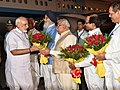 Narendra Modi being welcomed by the Governor of Punjab and Haryana and Administrator, Union Territory, Chandigarh, Prof. Kaptan Singh Solanki, the Chief Minister of Punjab (2).jpg