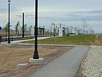 North along walkway to South Jordan Parkway station, Apr 16.jpg