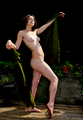 Nude woman with green drape in garden.png