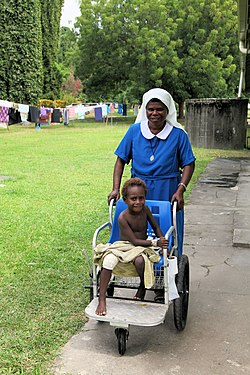 Nurse and patient at hospital in East New Britain, PNG.jpg