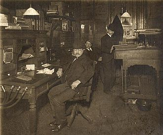 Speaking tube - An office in 1903, showing speaking tubes hanging on the end of a desk