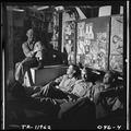 Officers aboard the USS Lexington (CV-16) chatting in the flight deck control office. - NARA - 520911.tif