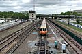 Orange Line train leaving Wellington station, May 2014.jpg