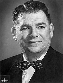 Studio photo of a smiling Oscar Hammerstein