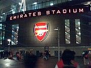 The Emirates Stadium sign is lit up at night