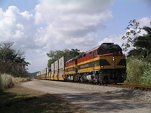 Panama Canal Railway - An intermodal train led by two Panama Canal F40PHs through Colón, Panama.