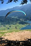 Paraglider @ Lake Bohinj (29320289685).jpg