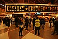 Passengers await trains at London Victoria.jpg
