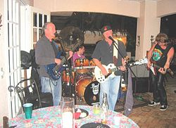 Paul Chapman playing a gig with Dave Currey and Blake Foster.jpg