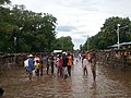 People stand in a flooded street that usually serves as a farmers market, in Ouanaminthe, northeast Haiti, Sept. 8, 2017. (Photo - Josiah Cherenfant, courtesy VOA Creole Service).jpg