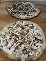 Pizza with mushrooms, cream sauces, and sausage.jpg