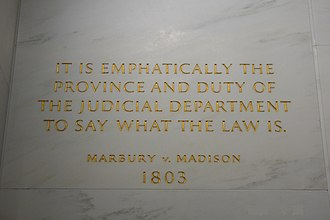 Marbury v. Madison - Inscription on the wall of the Supreme Court Building from Marbury v. Madison, in which Chief Justice John Marshall outlined the concept of judicial review.