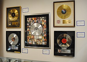 Maverick (company) - Platinum record (middle) for Madonna's 2001 greatest hits album, GHV2, released by Maverick Records.