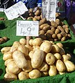 Potatoes for sale on a UK greengrocer's market stall 2013.jpg