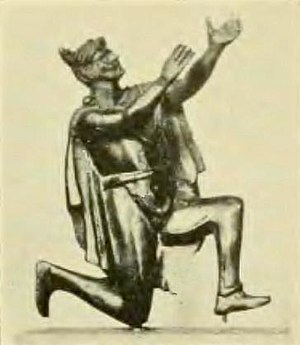 Ancient warfare - Roman bronze figurine depicting a Germanic man adorned with a Suebian knot engaged in prayer. (Bibliothèque Nationale, Paris)