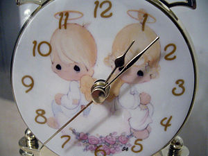 Precious Moments clock face.