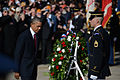 President Barack Obama, left foreground, bows his head while stepping backward after placing a wreath at the Tomb of the Unknowns at Arlington National Cemetery in Arlington, Va., during a Veterans Day 131111-D-DB155-005.jpg