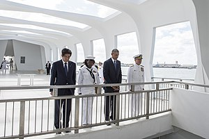 Harry B. Harris Jr. - ADM Harris, U.S. President Barack Obama, Japanese Prime Minister Shinzō Abe, and a U.S. Navy sailor render honors at the USS Arizona Memorial, 27 December 2016.