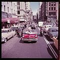 Presidential candidate Adlai Stevenson sits atop an open convertible in a parade going through a city street 19934 150px.jpg