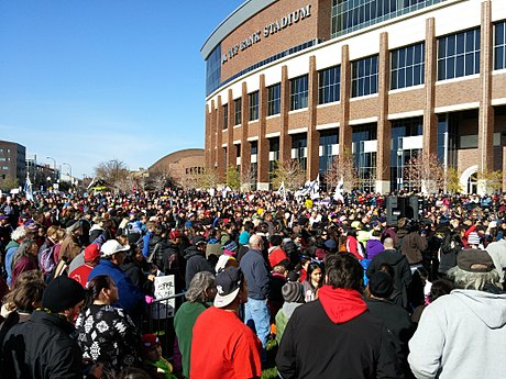 Native Americans and their supporters protest during the Washington Redskins name controversy. Protest against Washington football team name at TCF Stadium (15692618845).jpg