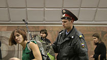 Pussy versus Putin Film Frame, Nadezhda Tolokonnikova Is Taken into Police Custody Moscow Metro 2011.jpg