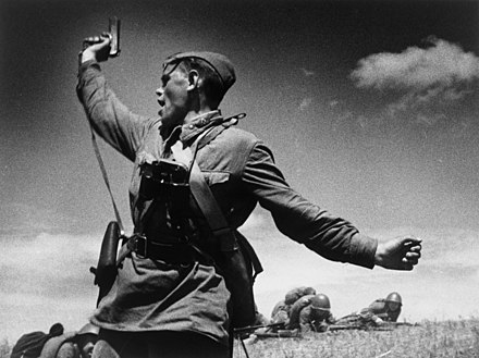 Iconic photo of a Soviet officer (thought to be Ukrainian Alexei Yeryomenko) leading his soldiers into battle against the invading German army, 12 July 1942, in Soviet Ukraine RIAN archive 543 A battalion commander.jpg