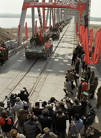 Soviet withdrawal from Afghanistan - A column of Soviet BTR-80s crossing the Hairatan bridge, the very last to withdraw from Afghanistan.