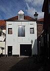 foto van Gepleisterd pakhuis met rechte kroonlijst