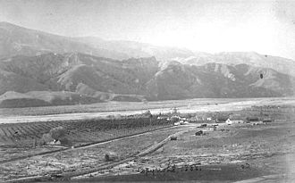 Rancho Camulos - Aerial view of the rancho in the Santa Clara River Valley in 1888, with vineyards on the left and the Santa Clara River in the background.