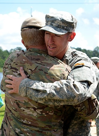 Ranger School - Ranger School graduate congratulated by his superior officer (June 2015).