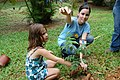 Refuge volunteer, Josayra Del Valle and Allannys find a worm as they dig to plant an endangered tree at the Puerto Rico Zoo. (5755674785).jpg