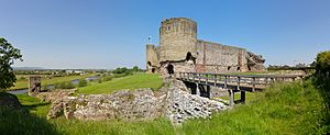 Rhuddlan Castle - One of the two gatehouses to the inner ward, with the walls of the outer ward running off to the left.