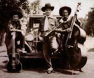 WDZ - Rhythm Riders: L to R 'skinny' masseneli, John Samuel Cox, Cecil Wright, posing with WDZ truck.